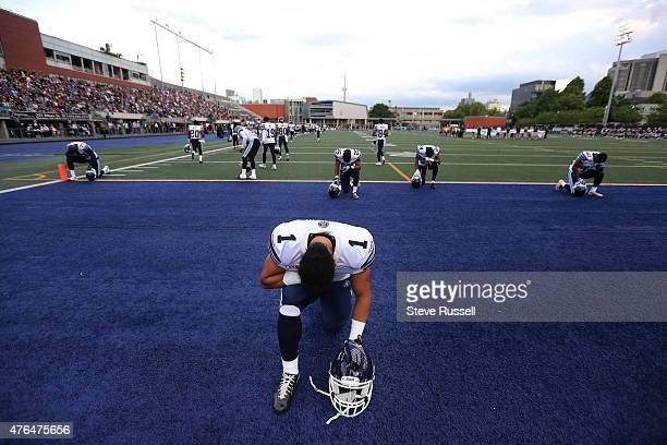 Ontario- JUNE 9 - Toronto Argonauts running back Anthony Coombs kneels for a prayer before the game as the Toronto Argonauts play the Winnipeg Blue...