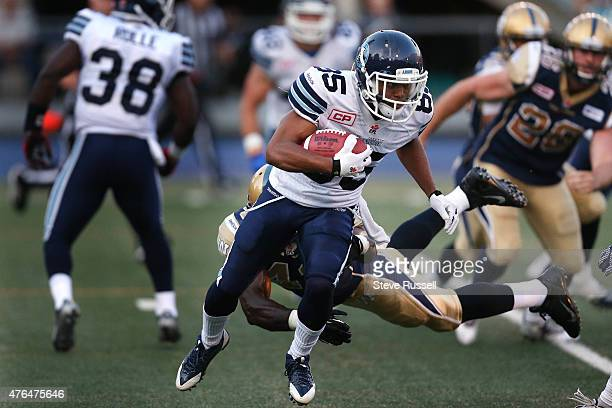 Ontario- JUNE 9 - Toronto Argonauts wide receiver Diontae Spencer avoids a tackle as the Toronto Argonauts play the Winnipeg Blue Bombers as Varsity...