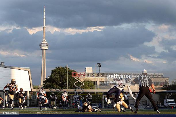 Ontario- JUNE 9 - Toronto Argonauts wide receiver Kevin Elliott is tackled as the Toronto Argonauts play the Winnipeg Blue Bombers as Varsity Stadium...