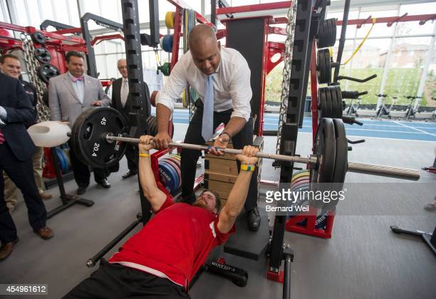 Ontario Minister of Sport & Culture Michael Coteau spots Sam Pedlow, with the National Beach Volleyball team, as he bench presses in the gym in the...