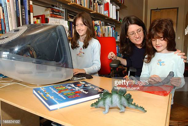 Ontario Mother in middle Rita Brooks with her two children On computer Cole age 9 and Hanna age 7 doing clay modelling They are being taught at home