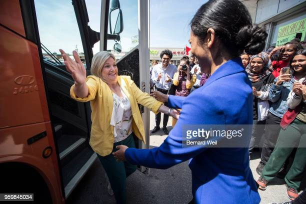 Ontario NDP leader Andre Horwath is greeted by local candidate Doly Begum in front of Bread King Bakeries during a campaign visit in the GTA