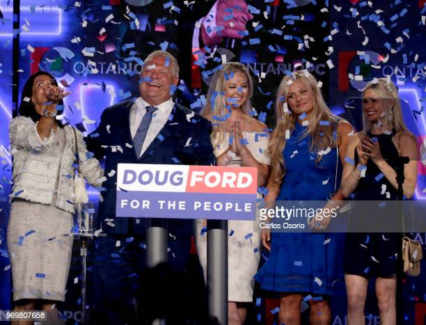 Ontario PC leader Doug Ford reacts after winning the Ontario Provincial election to become the new premier in Toronto on Thursday From left ate wife...