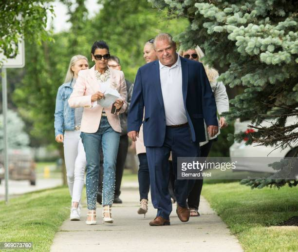 TORONTO ON DECEMBER 31 Ontario PC Leader Doug Ford walks with his wife Karla and family to St George's Junior School Polling Station 28 in Etobicoke...