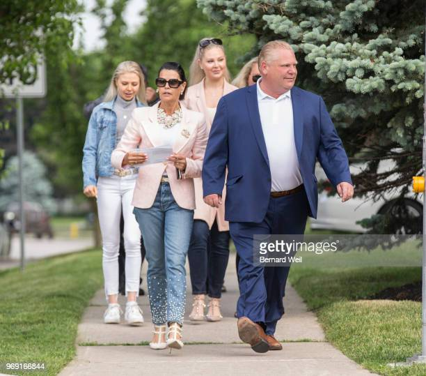 TORONTO ON JUNE 7 Ontario PC Leader Doug Ford walks with his wife Karla and family to St George's Junior School Polling Station 28 in Etobicoke to...