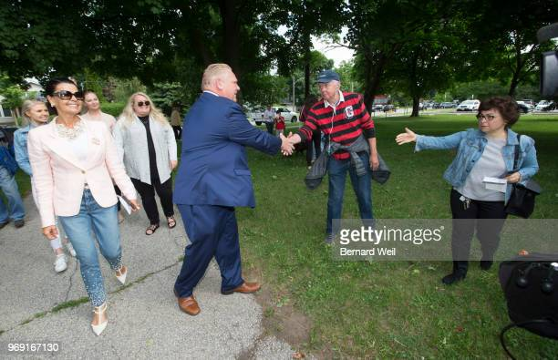 TORONTO ON JUNE Ontario PC Leader Doug Ford walks with his wife Karla and family to St George's Junior School Polling Station 28 in Etobicoke to cast...