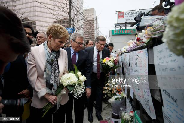 Ontario Premier Kathleen Wynne and Toronto Mayor John Tory visit a memorial for victims of the mass killing on Yonge St at Finch Ave on April 24 2018...
