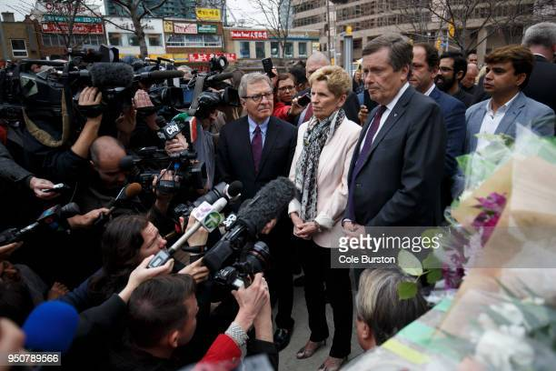 Ontario Premier Kathleen Wynne middle and Toronto Mayor John Tory right visit a memorial for victims of the mass killing on Yonge St at Finch Ave on...