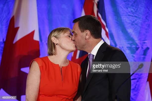 Ontario Progressive Conservative leader Tim Hudak right announces next to his wife Deb Hutton that he will be stepping down as party leader after...