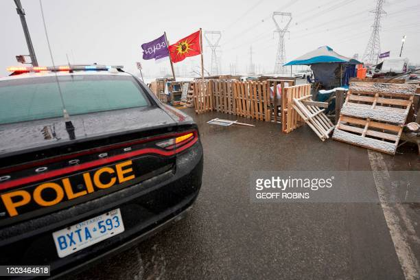 Ontario Provincial Police and First Nations protestors sit on opposite sides of a barricade on Highway 6 near Caledonia Ontario which the protestors...