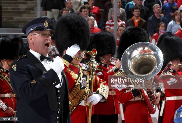 Ontario Provincial Police constable Lyndon Slewidge sings the national anthems with the Governor General's Footguards band prior to the Ottawa...