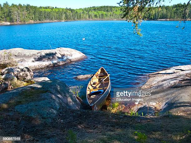 Ontario Quetico Park Lake Kawnipi wilderness Beached Canoe