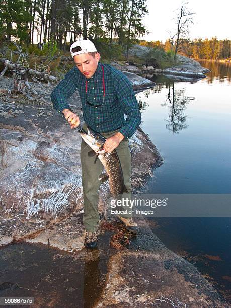 Ontario Quetico Park Lake Kawnipi wilderness removing the hook from walleye