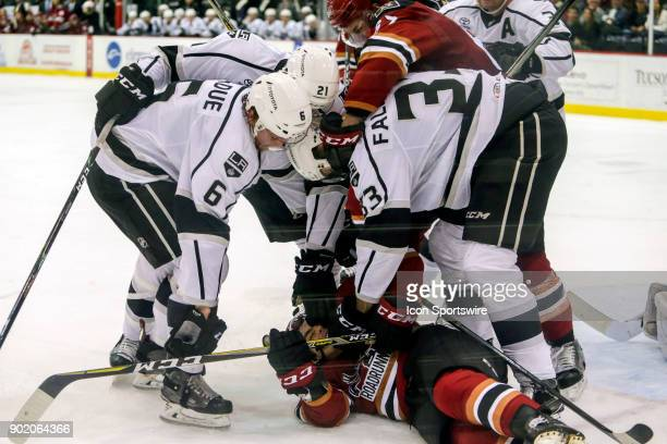 Ontario Reign defenseman Paul Ladue Ontario Reign center Andrew Crescenzi and Ontario Reign defenseman Stepan Falkovsky holds down Tucson Roadrunners...