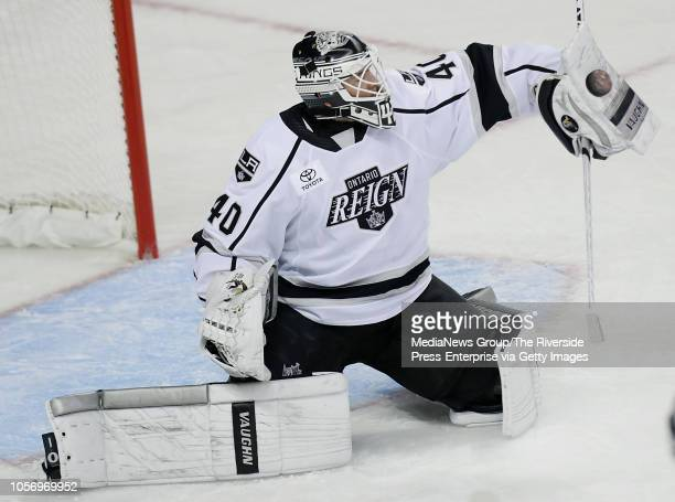 Ontario Reign goaltender Cal Petersen blocks a Milwaukee Admirals shot during the game at Citizens Business Bank Arena in Ontario on Wednesday...