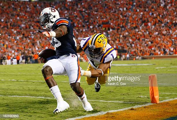 Onterio McCalebb of the Auburn Tigers scores a touchdown past Eric Reid of the LSU Tigers at Jordan Hare Stadium on September 22 2012 in Auburn...