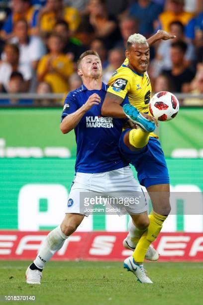 Onur Bulut of Braunschweig challenges Marvin Pourie of Karlsruhe during the 3 Liga match between Eintracht Braunschweig and Karlsruher SC at...