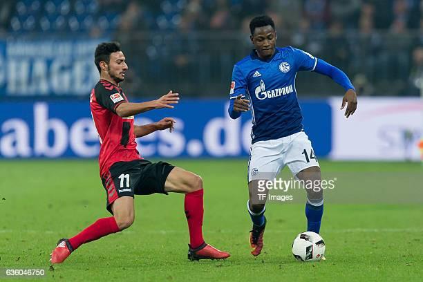 Onur Bulut of Freiburg and Abdul Rahman Baba of Schalke battle for the ball during the Bundesliga match between FC Schalke 04 and SC Freiburg at...