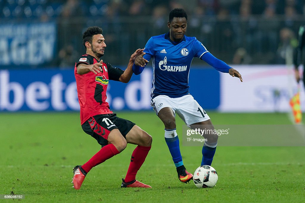 Onur Bulut of Freiburg and Abdul Rahman Baba of Schalke battle for the ball during the Bundesliga match between FC Schalke 04 and SC Freiburg at Veltins-Arena on December 17, 2016 in Gelsenkirchen, Germany.