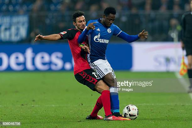 Onur Bulut of Freiburg and Abdul Rahman Baba of Schalke battle for the ball during the Bundesliga match between FC Schalke 04 and SC Freiburg at...