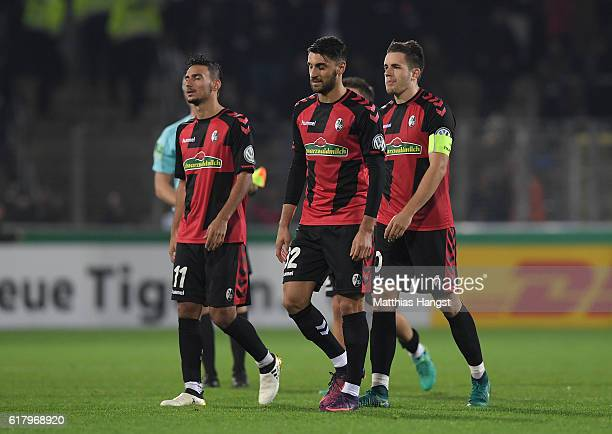 Onur Bulut of Freiburg Vincenzo Grifo of Freiburg and Christian Guenter of Freiburg show their disappointment after the DFB Cup match between SC...