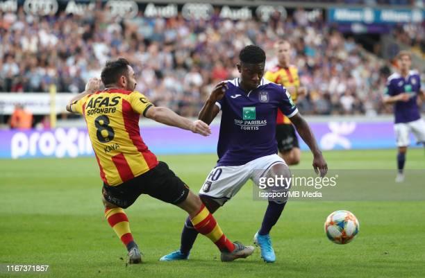 Onur Kaya of Kv Mechelen battles for the ball with Francis Amuzu of Anderlecht during the Jupiler Pro League match between RSC Anderlecht and KV...