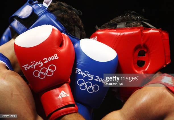 Onur Sipal of Turkey is tangled-up with Jose Pedraza Gonzalez of Puerto Rico during their men's 60kg light weight bout in the boxing event at the...