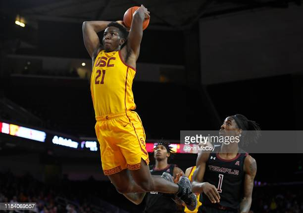 Onyeka Okongwu of the USC Trojans gets past Quinton Rose of the Temple Owls for a dunk in the second half at Galen Center on November 22, 2019 in Los...