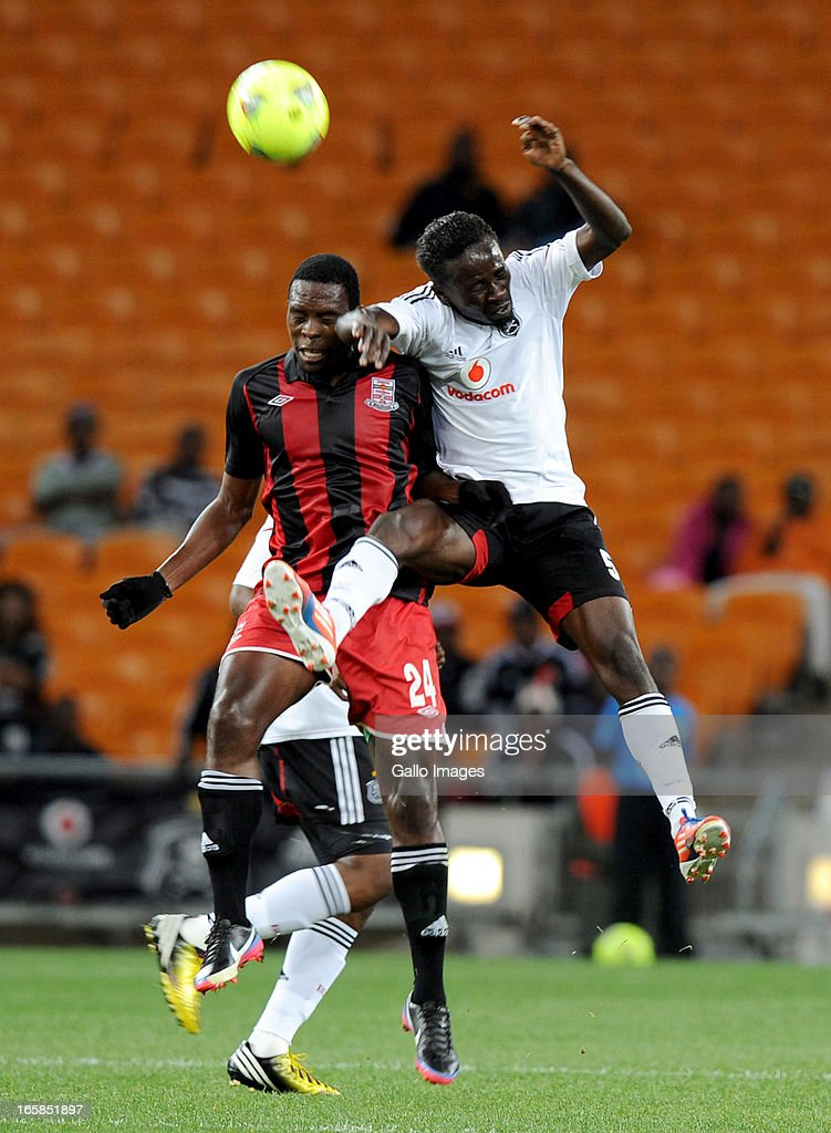 Onyekachi Okonkwo of Orlando pirates battling for the ball with Samson Chilupe of Zanaco FC during the CAF Confedaration Cup match between Orlando Pirates and Zanaco at FNB Stadium on April 06, 2013 in Johannesburg, South Africa.