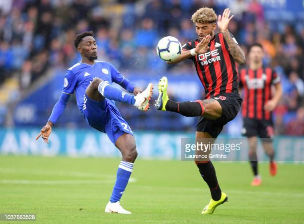 Shinji Okazaki of Leicester City avoids a clearance from Mathias Zanka of Huddersfield Town during the Premier League match between Leicester City...