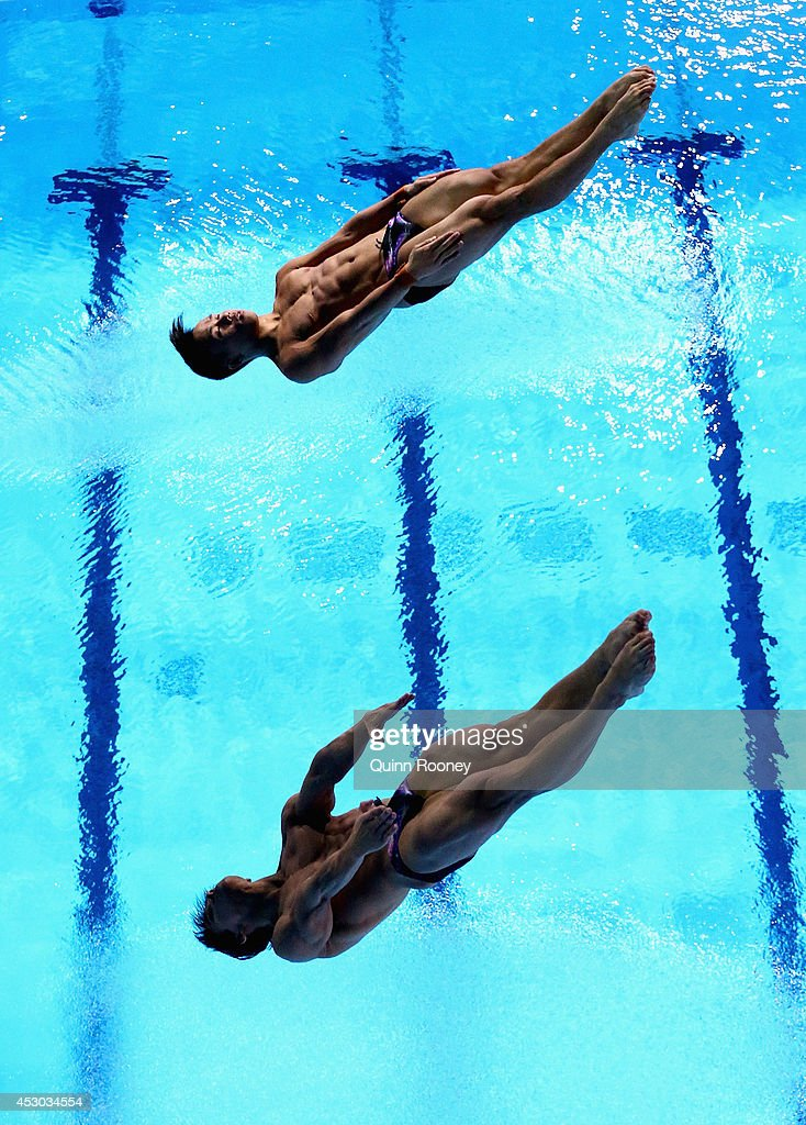 Ooi Tze Liang and Chew Yiwei of Malaysia compete in the Men's Synchronised 10m Platform Final at Royal Commonwealth Pool during day nine of the Glasgow 2014 Commonwealth Games on August 1, 2014 in Edinburgh, Scotland