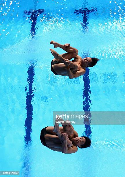 Ooi Tze Liang and Chew Yiwei of Malaysia compete in the Men's Synchronised 10m Platform Final at Royal Commonwealth Pool during day nine of the...