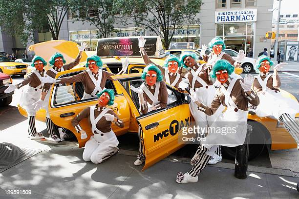 """Oompa Loompas hand out Golden Tickets for the """"40th Anniversary of Willy Wonka & The Chocolate Factory"""" event on October 18, 2011 in New York City."""
