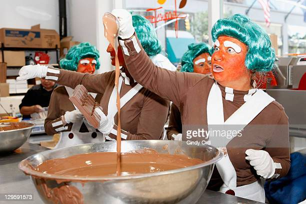 """Oompa Loompas hands out Golden Tickets for the """"40th Anniversary of Willy Wonka & The Chocolate Factory"""" event on October 18, 2011 in New York City."""