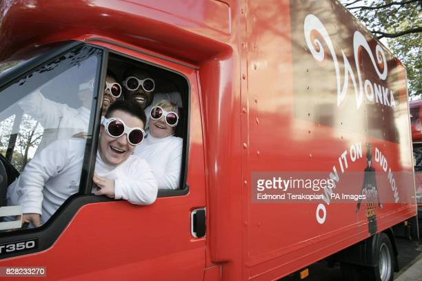 Oompa Loompas headed by Andy Inns in one of the three Wonka trucks during the launch of the 'Charlie and the Chocolate Factory' DVD central London...