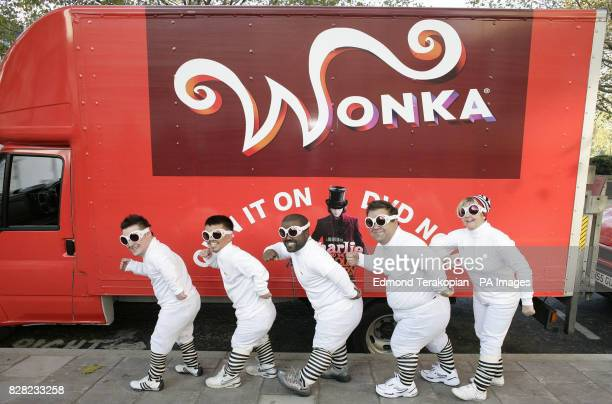 Andy Inns Danny Roberts Michael Caballero Jamie Legg and Denise Dove make their way to one of the three Wonka trucks during the launch of the...