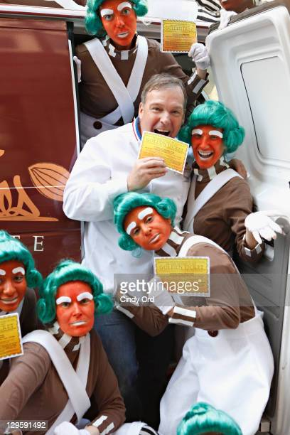 Oompa Loompas pose with Chef Jacques Torres as they hand out Golden Tickets for the 40th Anniversary of Willy Wonka The Chocolate Factory event on...