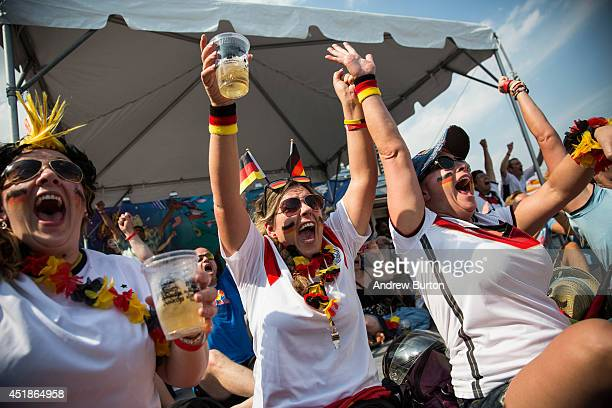 Oona Hodos Nathalie Dorner and Natascha Cozby celebrate after a German goal in the Germany vs Brazil semifinal World Cup game on July 8 2014 in New...
