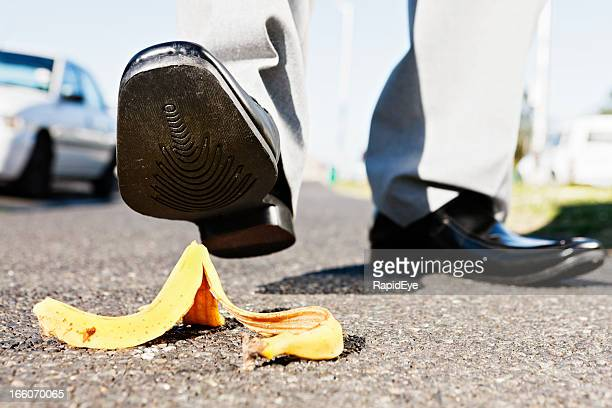 Ooops! Businessman about to step on banana peel