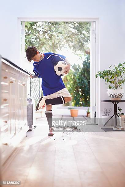 oops! better clean that up before mom sees - football strip stock pictures, royalty-free photos & images