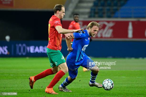 Oostende's Brecht Capon and Gent's Roman Bezus fight for the ball during a soccer match between KAA Gent and KV Oostende, Monday 08 March 2021 in...