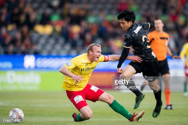 Oostende's Kevin Vandendriessche and STVV's Wataru Endo fight for the ball during a soccer match between KV Oostende and Sint Truidense VV Wednesday...