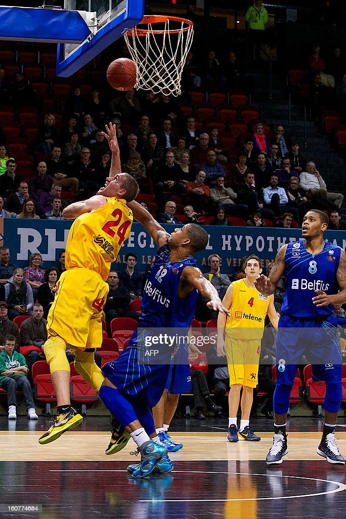 Oostende's Matt Lojeski and Mons' Josh Bostic fight for the ball during the match between Oostende and Mons-Hainaut, a return game of the semi final of Belgian basket cup, on February 5, 2013 in Oo...