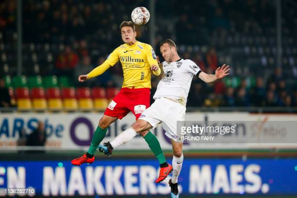Oostende's Sindrit Guri and Eupen's Siebe Blondelle fight for the ball during a soccer match between KV Oostende and KAS Eupen Saturday 30 March 2019...