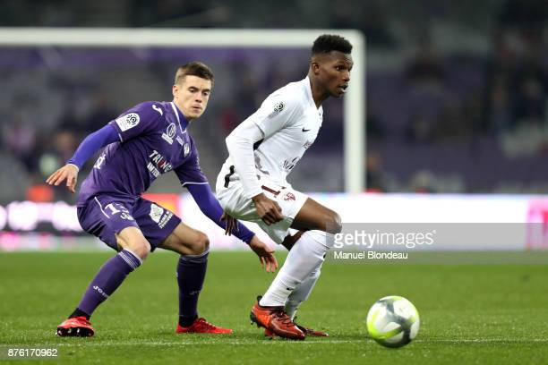 Opa Nguette of Metz and Clement Michelin of Toulouse during the Ligue 1 match between Toulouse FC and FC Metz at Stadium Municipal on November 18...