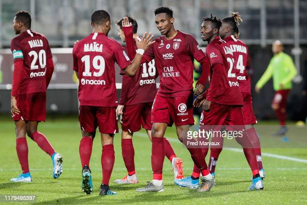Opa Nguette of Metz celebrates scoring his goal during the Ligue 1 match between FC Metz and Montpellier HSC at Stade SaintSymphorien on November 2...