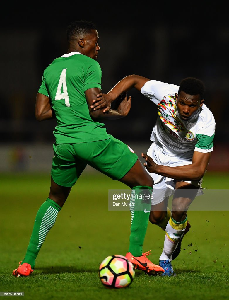 Opa Nguette of Senegal takes on Kenneth Omeruo of Nigeria during the International Friendly match between Nigeria and Senegal at The Hive on March 23, 2017 in Barnet, England.