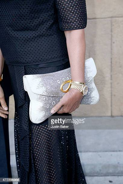 Opal Perlman purse detail attends Skin Trade Los Angeles Premiere at the Egyptian Theatre on May 6 2015 in Hollywood California