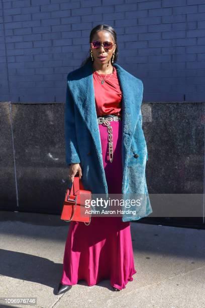 Opal Stewart a blue Yumi Kim jacket a magenta Emma Wallace shirt and a red Danielle Nicole bag on the street during New York Fashion Week on February...