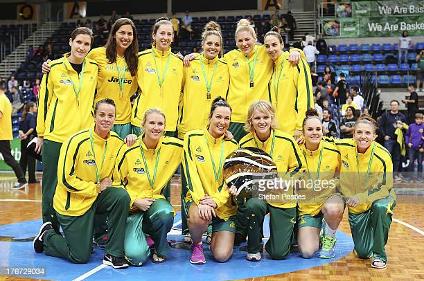 Opals pose for a team photo after winning the Women's FIBA Oceania Championship match between the Australian Opals and the New Zealand Tall Ferns at...